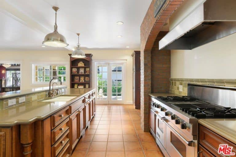 The kitchen features walnut-finished cabinetry as well.