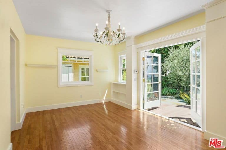This room features a french doorway leading to the home's backyard.