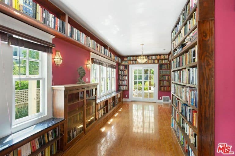 There's a huge library in the house too featuring long bookshelves.