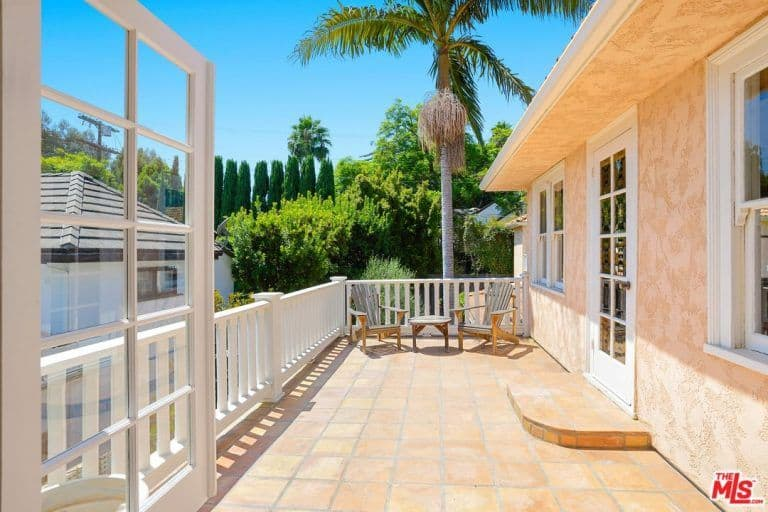 Another patio on the balcony overlooks the beautiful outdoor area of the property.