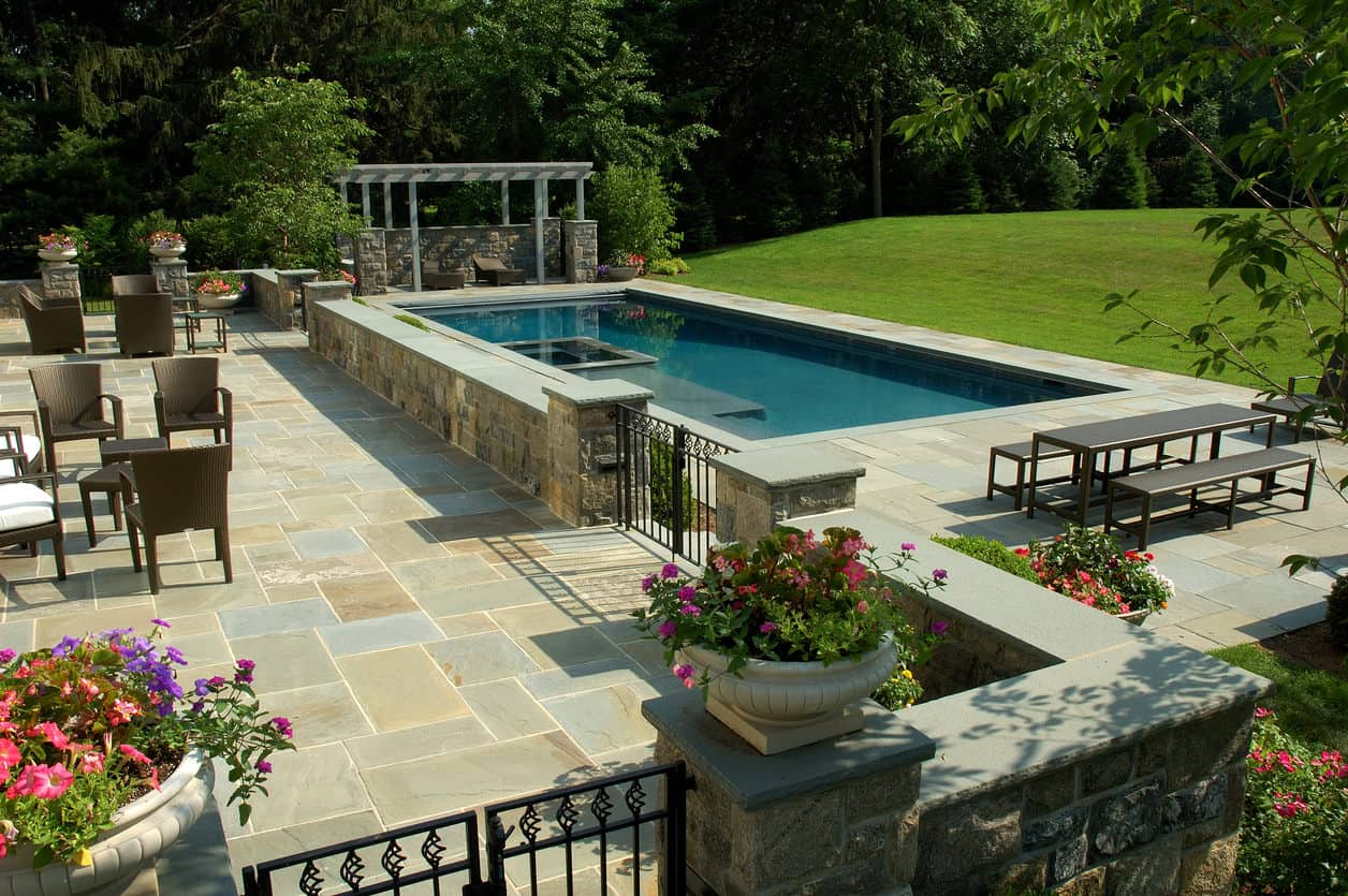 Here's a huge rectangle pool on a massive property with an absolutely humongous patio area. That is a lot of stonework.
