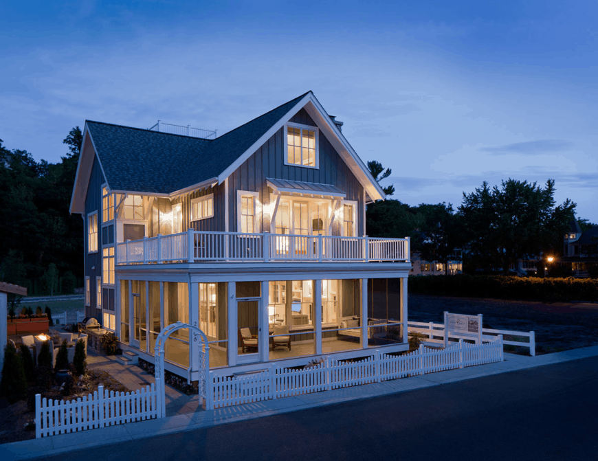 Large beach home with an amazing deck and a stylish gray exterior.