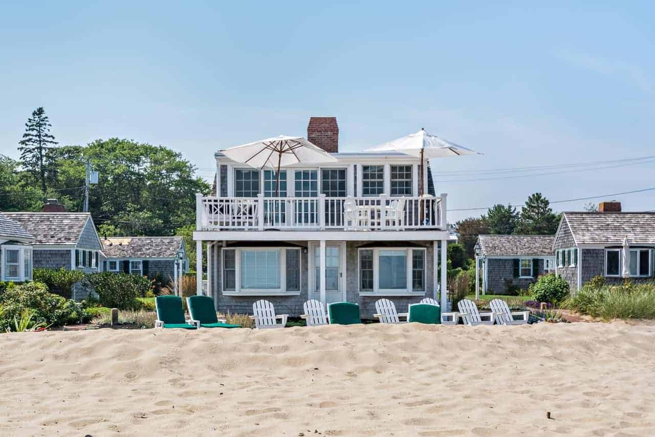 A beautiful tiny beach house with a nice balcony area and multiple sitting lounges.