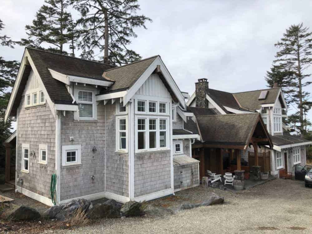 This beach house features two separate wings, both with gray exteriors.
