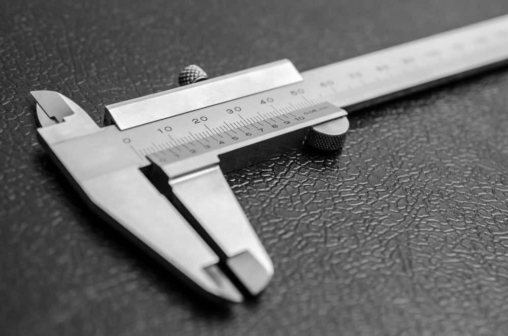 Caliper on black leather background.