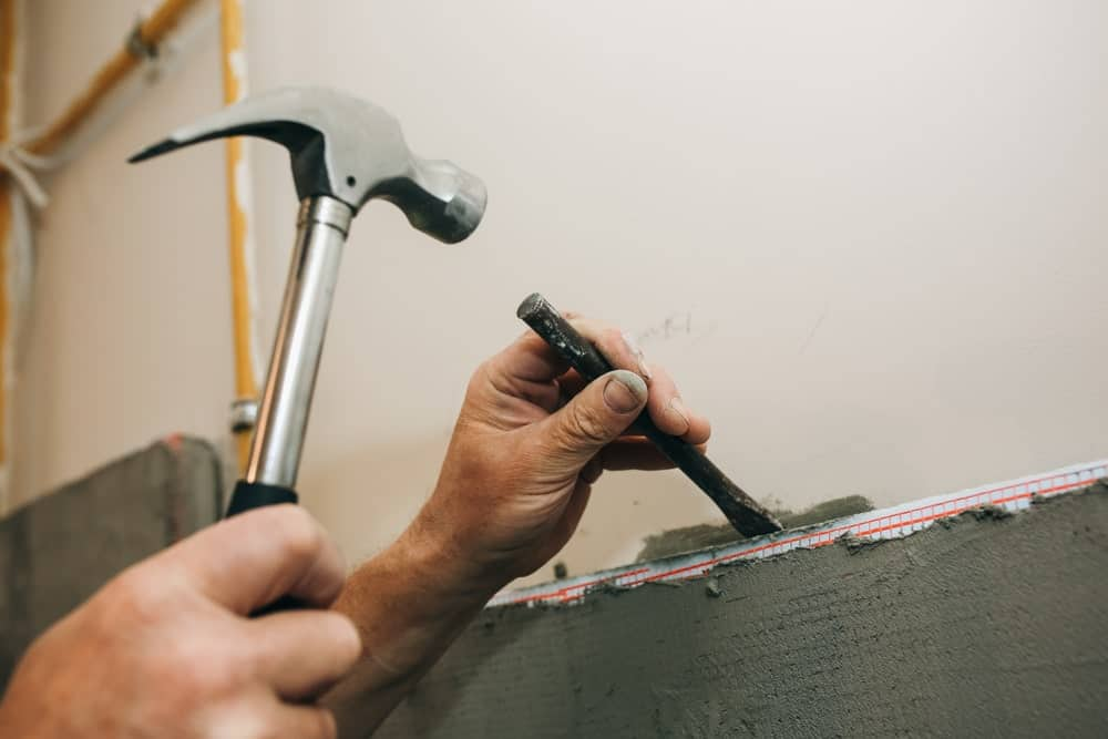 Hammer used with the chisel to remove grouts from wall tiles.
