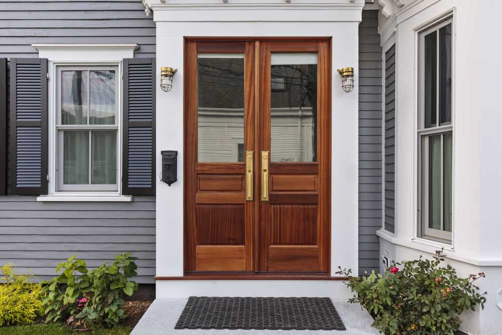 Wood front door with clear glass windows