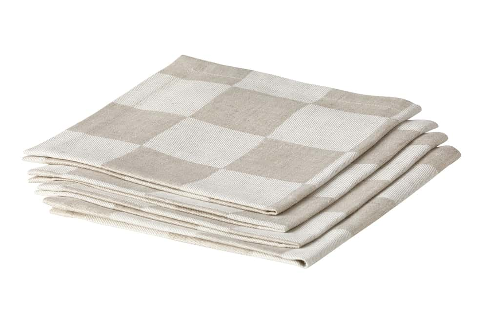 Folded checkered linen napkins on white background.