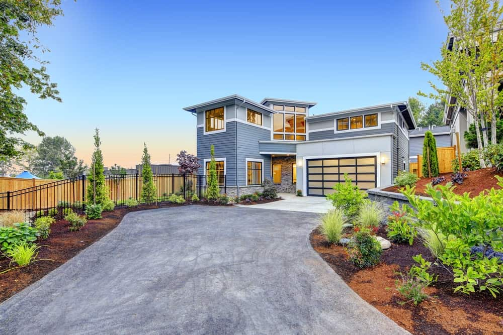 Craftsman house with one-door garage, two-level interior, flat roofing, and asphalt driveway.