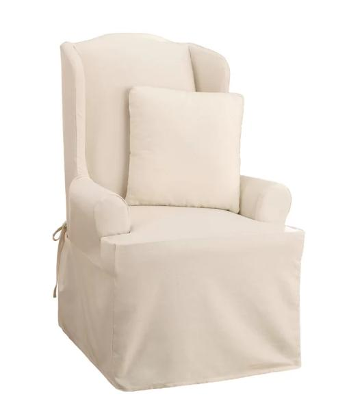 Cream-colored slipcover with ties.