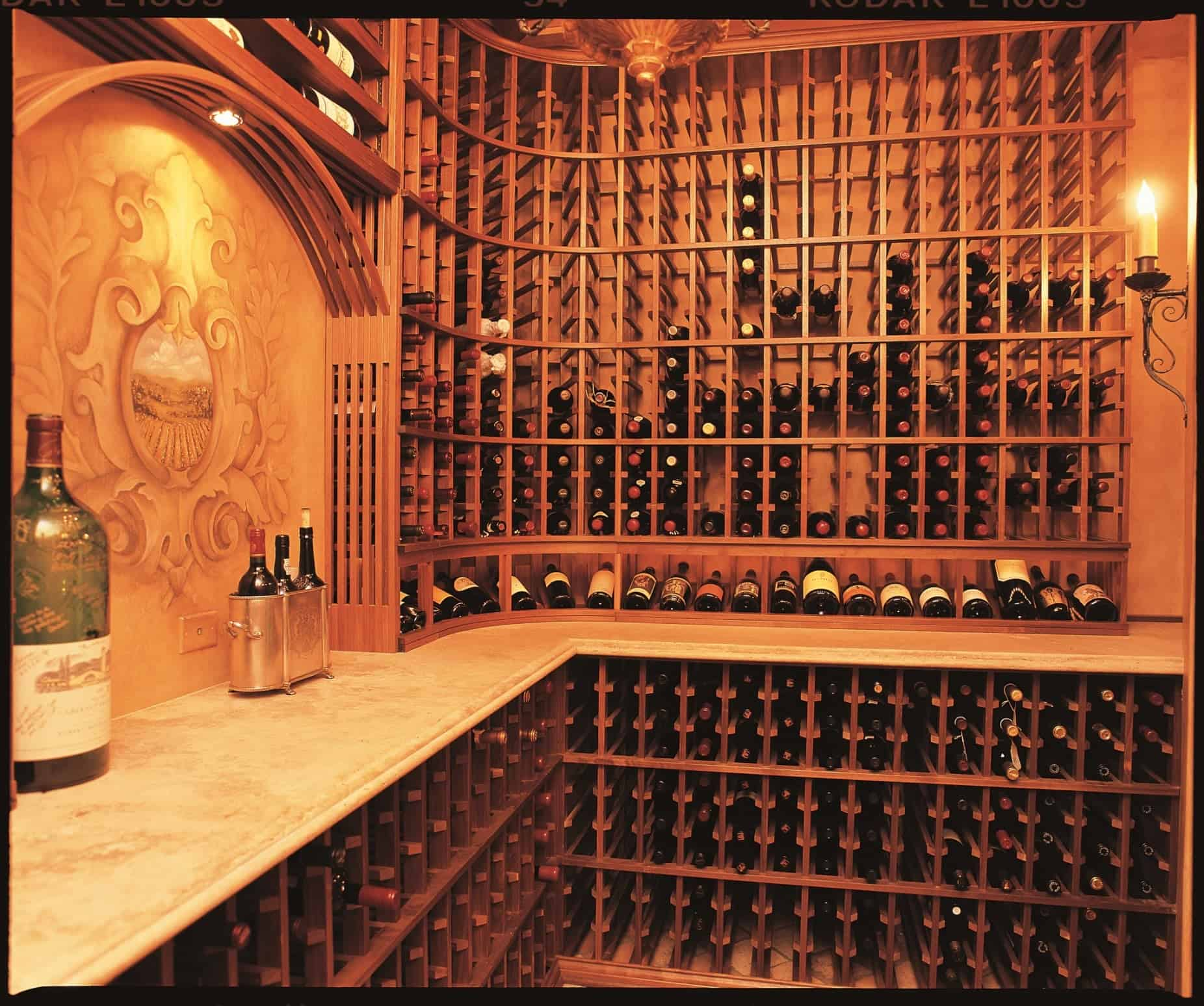 Example of custom wood wine storage racking with countertops built into the wine cellar.