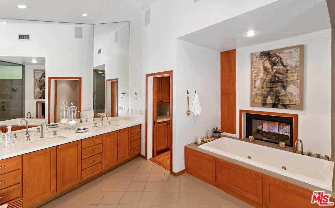 The bathroom has a complete sinks, soaking tub and a shower area.