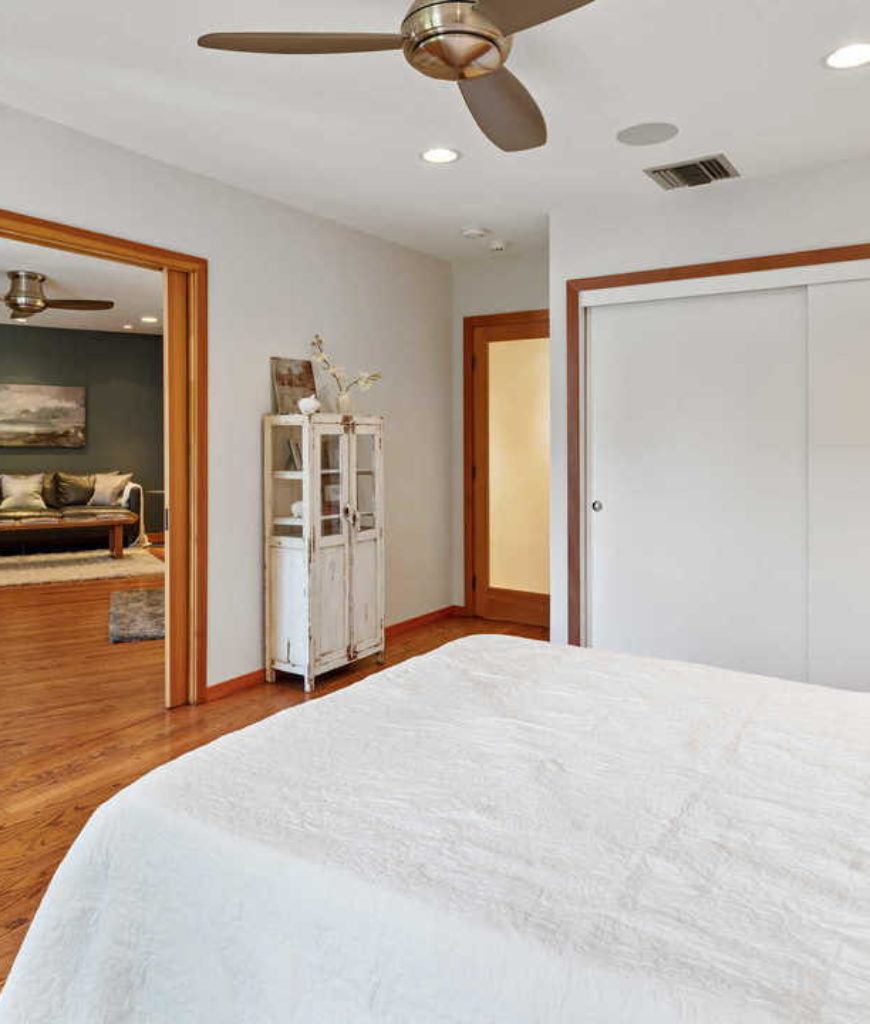 This view of the master suite showcases its large bedroom space with a its own private living space.