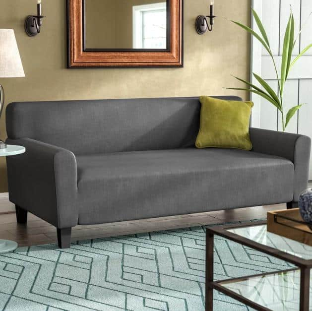 ox cushion slipcover in a matte, dark gray finish.
