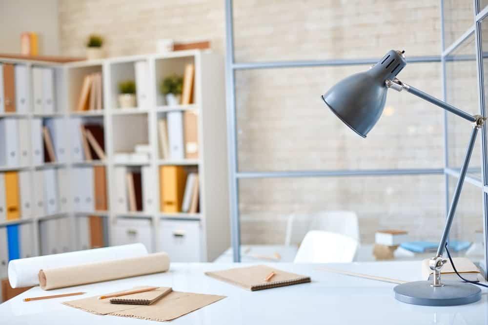 A desk lamp on an architect's office desk.