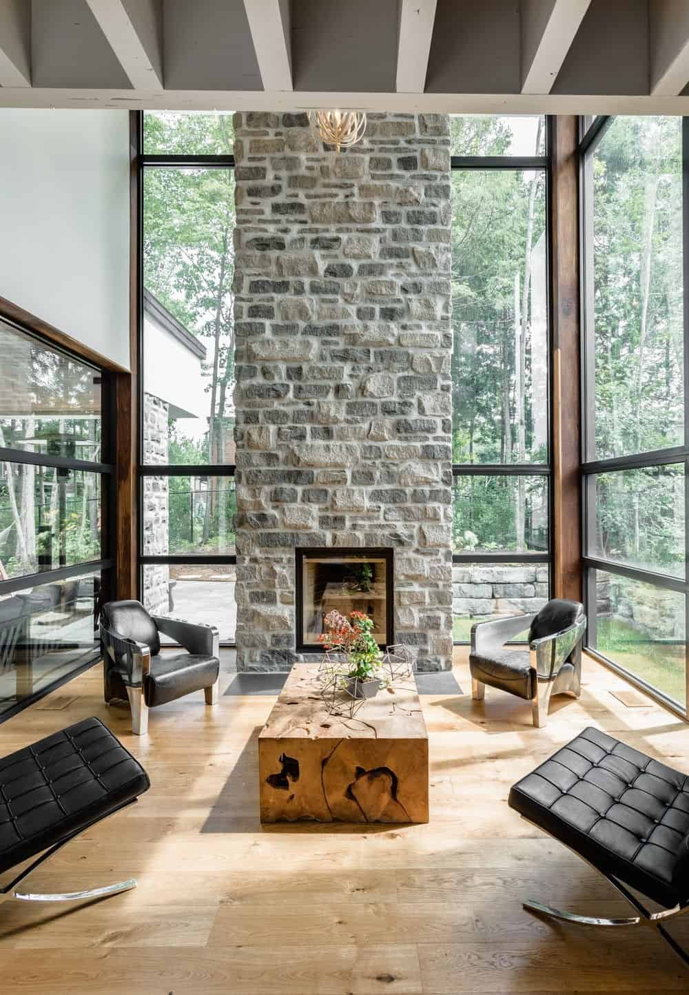 The living room boasts a modish style with tall brick fireplace. Photo credit: Dominic Boudreau