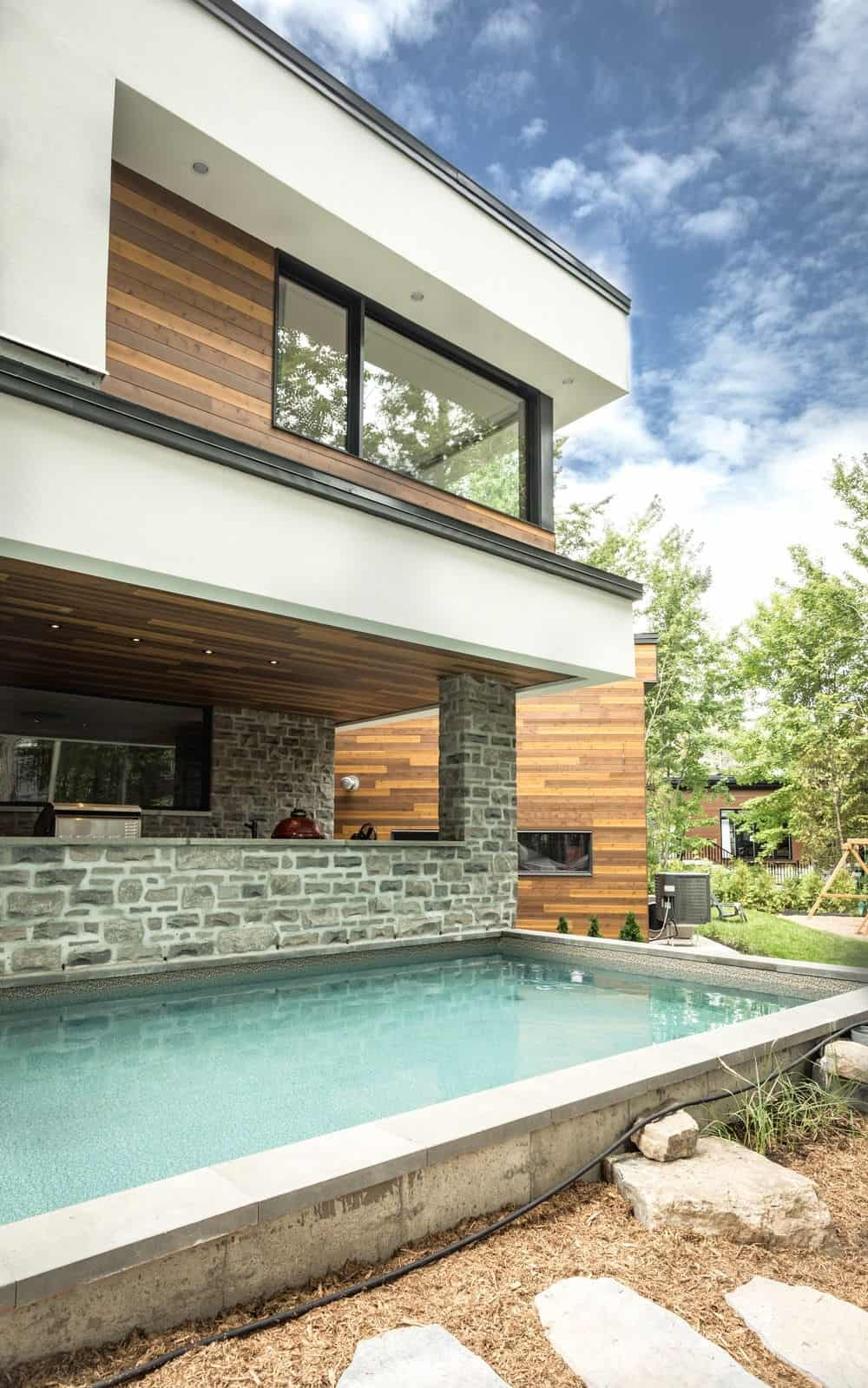 The Outdoor Area Features A Rectangular Swimming Pool. Photo Credit:  Dominic Boudreau