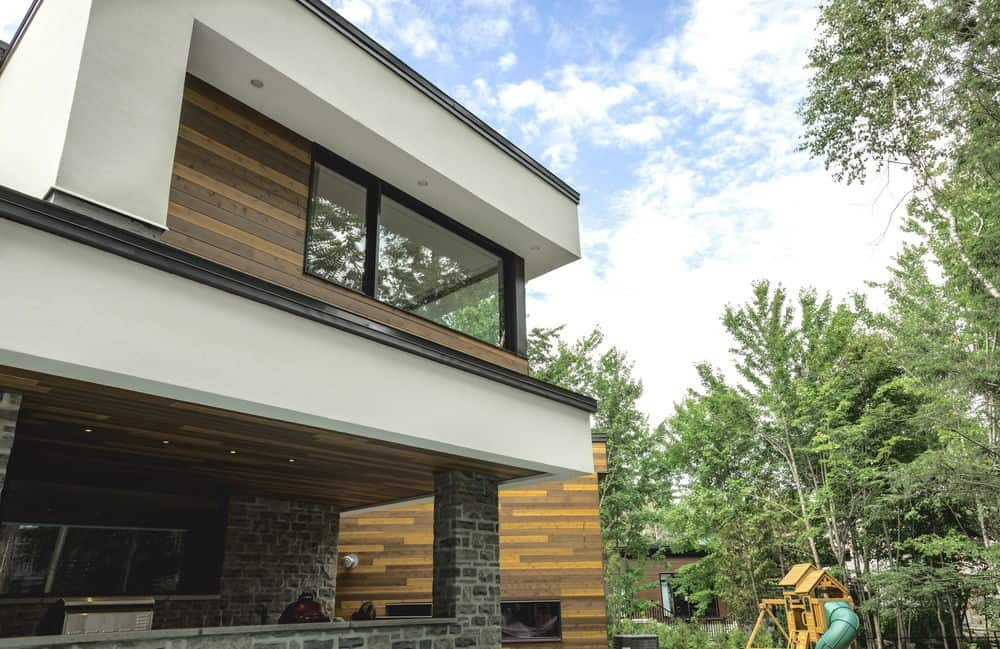 Another view at the home's outdoor showcasing its stunning architecture and landscaping. Photo credit: Dominic Boudreau