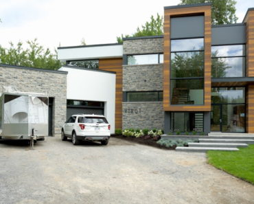 Outside view of the home featuring its garage and front entryway. Photo credit: Dominic Boudreau