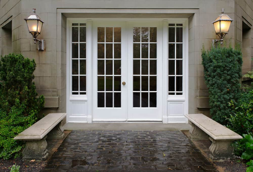 Large white double front door with glass (as well as glass sidelites)