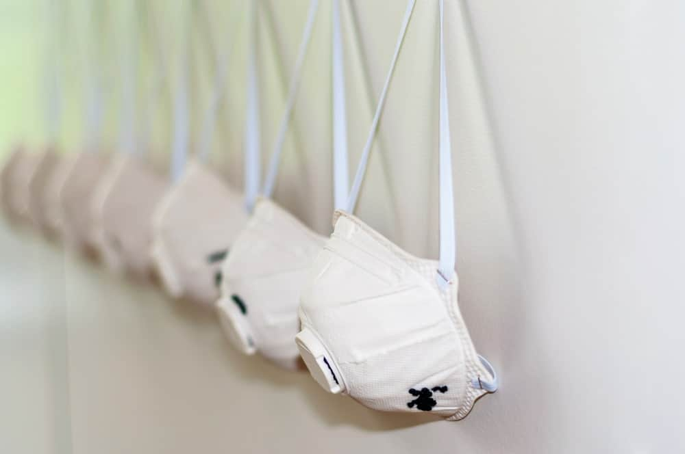 A row of dust masks on white background.