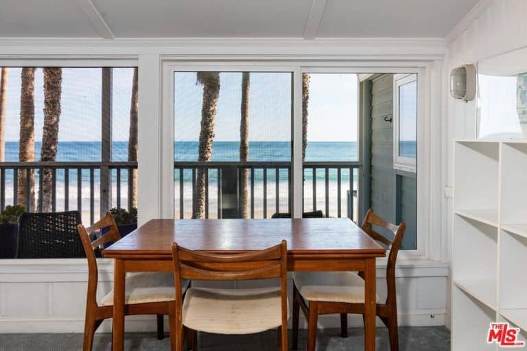 The dining area overlooks the beautiful beach front.