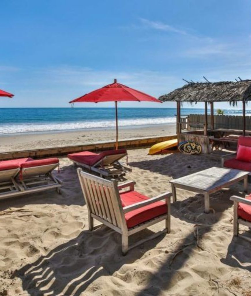The patio area and relaxing lounges are facing the beautiful oceanfront.