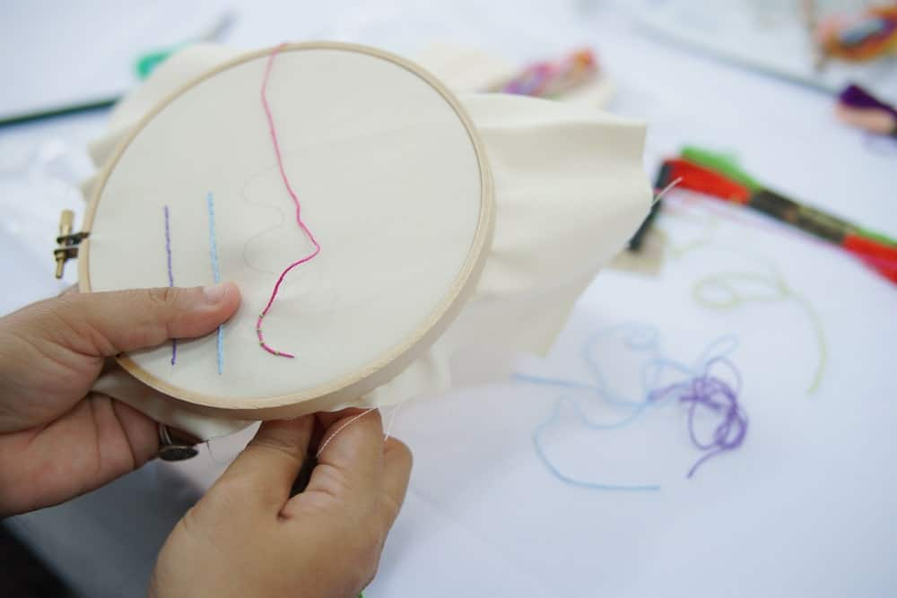 Embroidery stitch using an embroidery hoop.