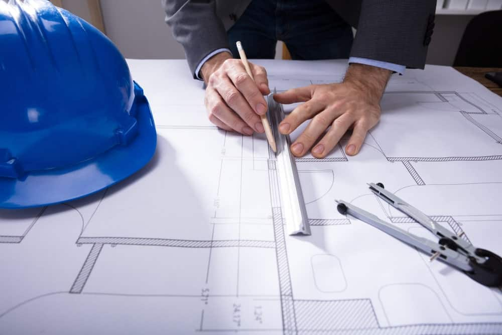 An architect/engineer uses the engineer's scale ruler.