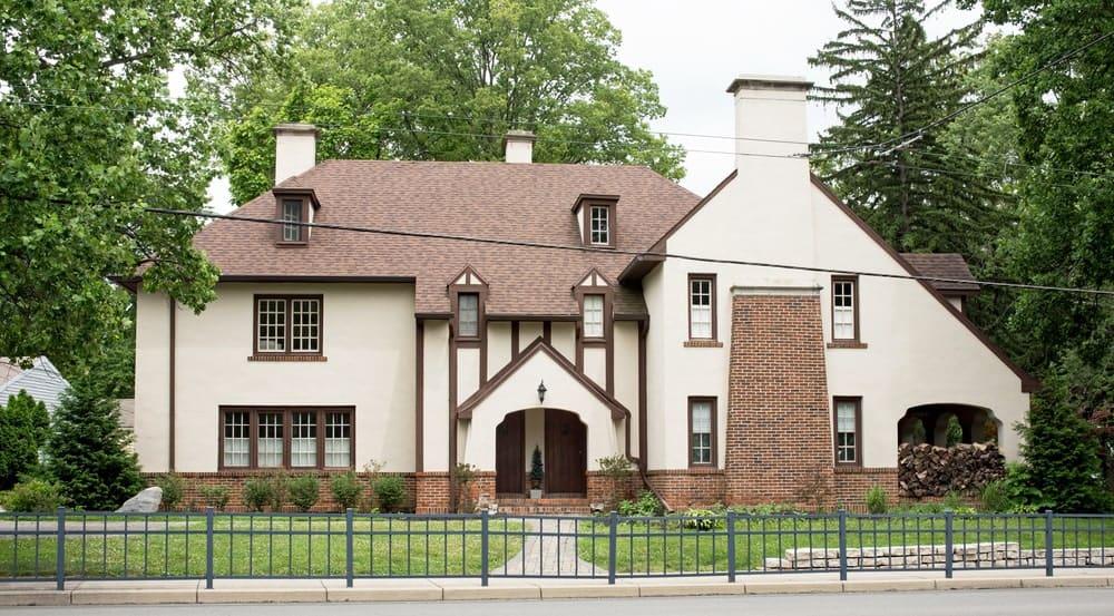 English Tudor house with brick decoration and foundation.