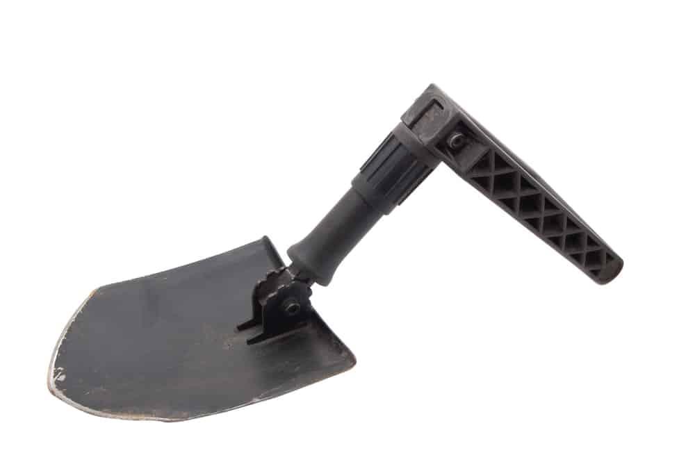 Folding shovel on white background.