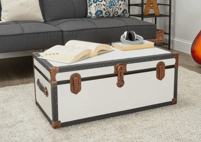 Footlocker for shoe storage doubling as a coffee table.