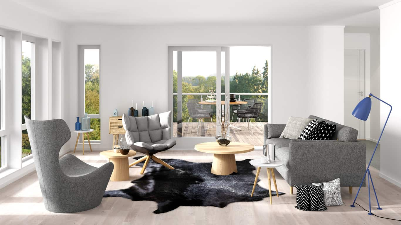 Small formal living room in the Scandinavian style with classic Scandinavian style gray furniture centered around two small natural wood round coffee tables all on a very light wood floor.