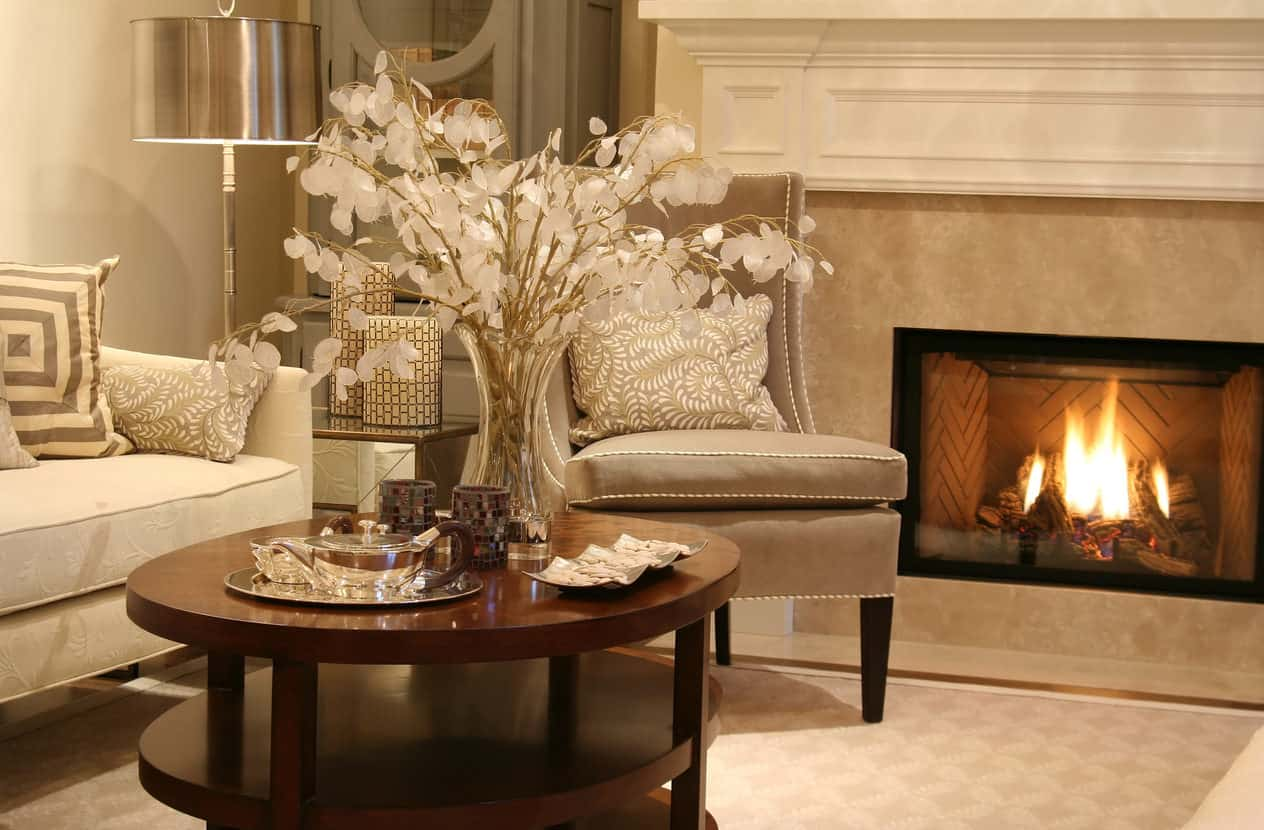 Elegant formal living room with sofa, round coffee table and fireplace