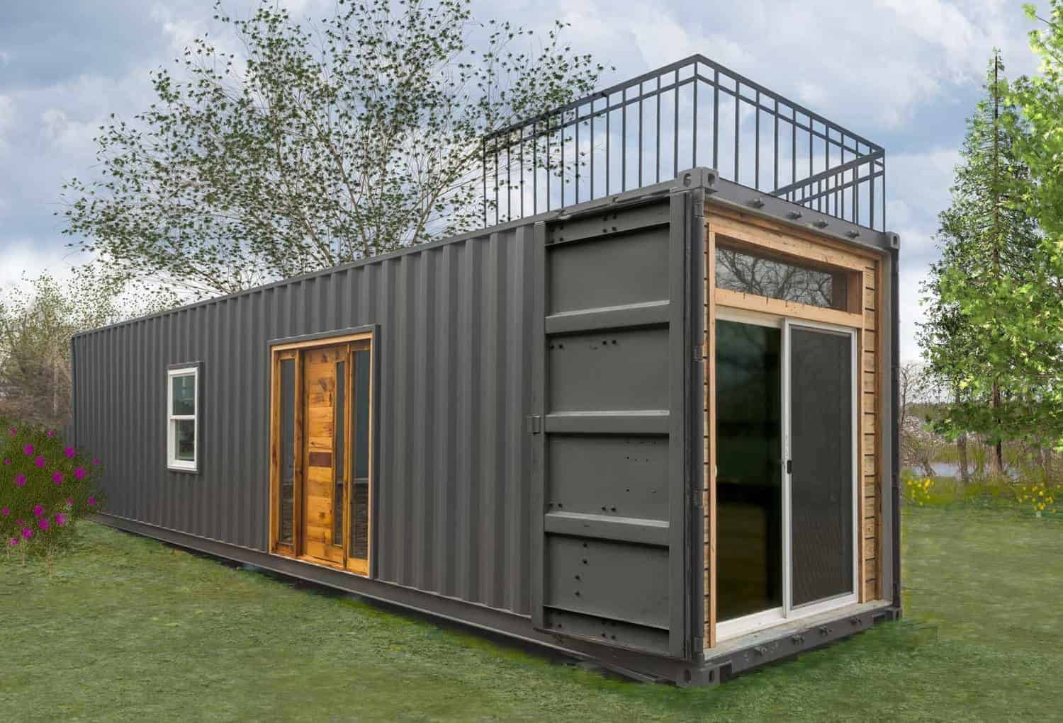 A tiny container house with amazing kitchen inside. The exterior is painted in gray.