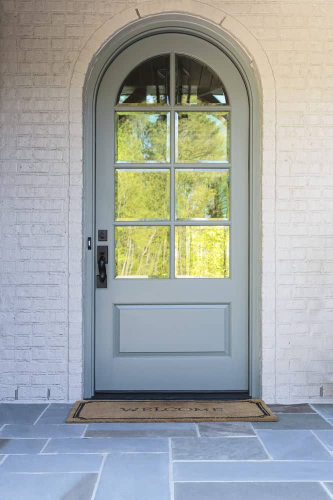 Arched front door with arched glass window