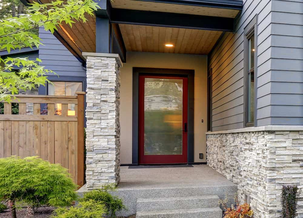 Full glass front door with wood frame