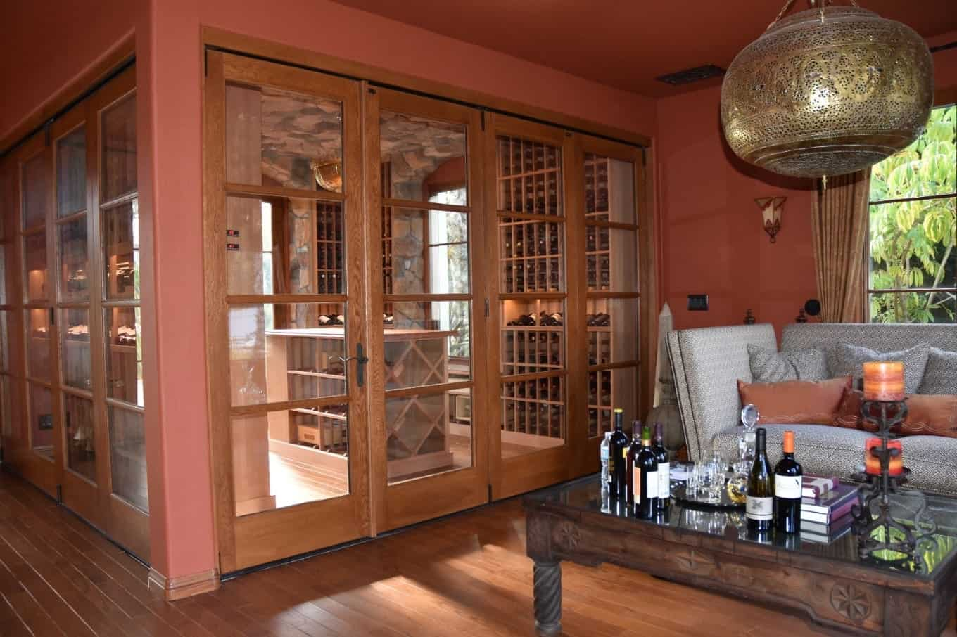 Glassed-in wine cellar with tasting island.  You can see this wine cellar from the living room.