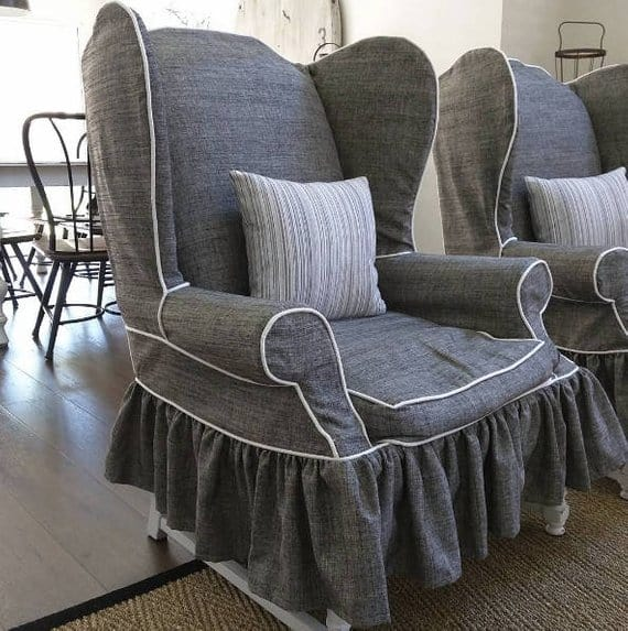 Gray, custom-made slipcover with a white lining.
