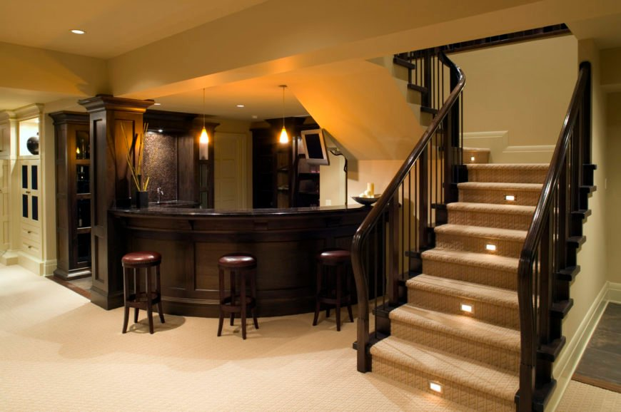 This bar features dark finished counter and chairs along with black granite countertop lighted by lovely pendant lights.