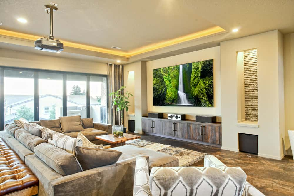 Above is an example of a media room or essentially a family room with a huge wall-mounted TV and comfortable seating.  This is my type of media room.  These days with huge TVs and awesome sound systems, a full blown theater really isn't necessary.