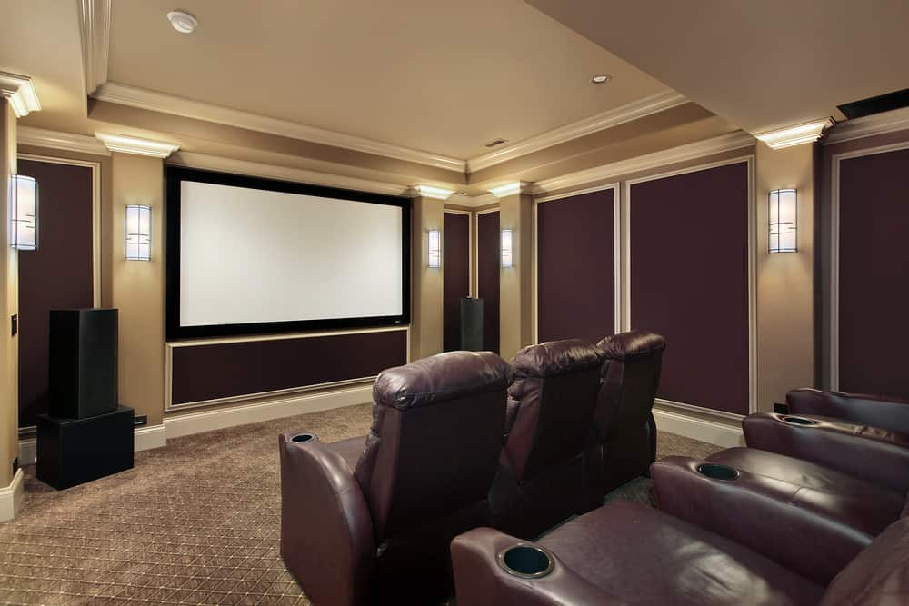 This home theater boasts stylish walls and lighting, along with the classy carpet flooring and well-placed theater seats.