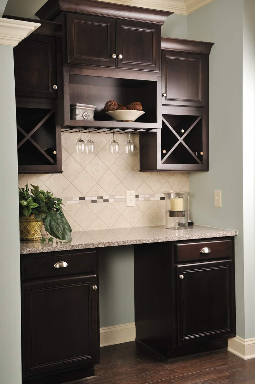 Great built-in small dark wood wet bar built into a small nook.