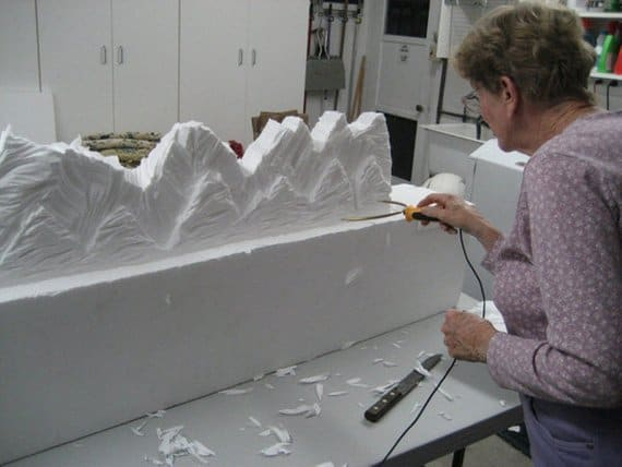 Old lady sculpting the styrofoam.