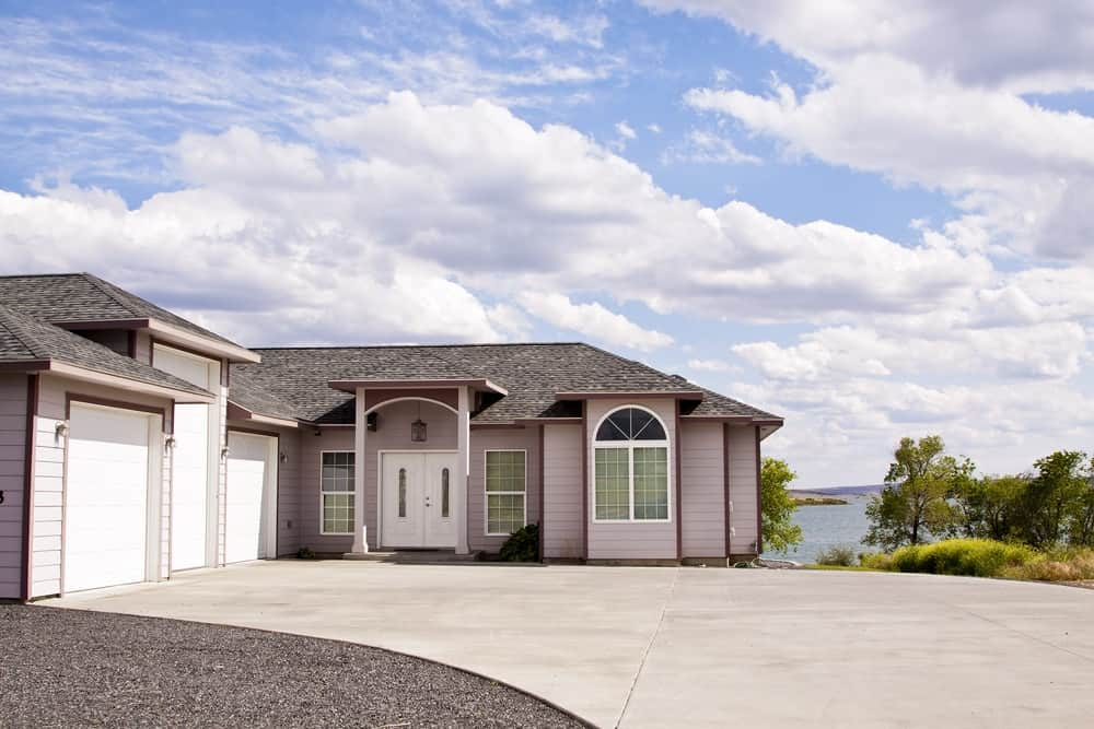 Bungalow-style house with a concrete driveway.
