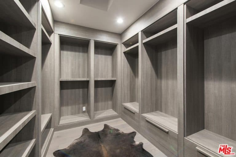 The closet features a stylish cabinet.