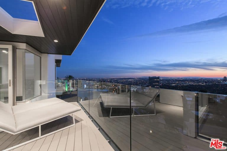The deck features relaxing lounges while overlooking the city of Los Angeles.