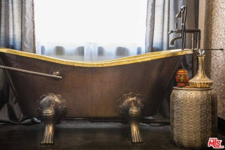 Close up view at the bathroom's stunning copper-finished bathtub.