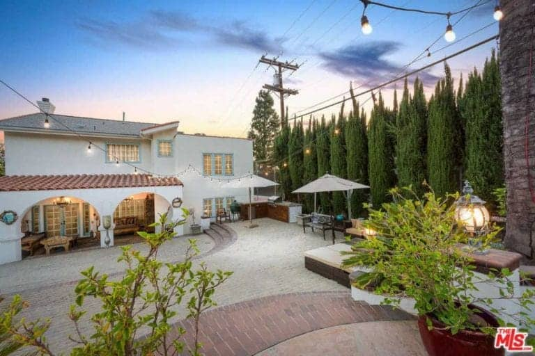 The outdoor area features a patio area, outdoor kitchen, dining space and multiple relaxing lounges.