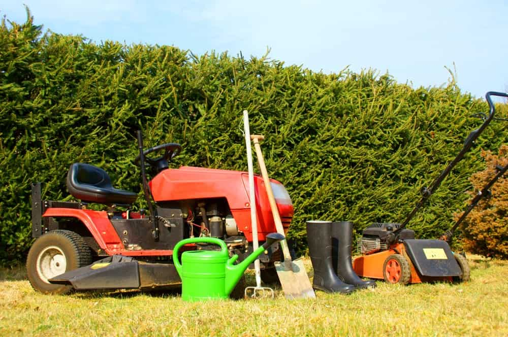 All types of lawn maintenance tools displayed on the lawn.